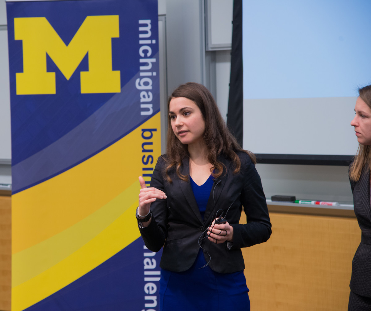 Close-up of well-dressed Ross Business School student presenting for the Michigan Business Challenge